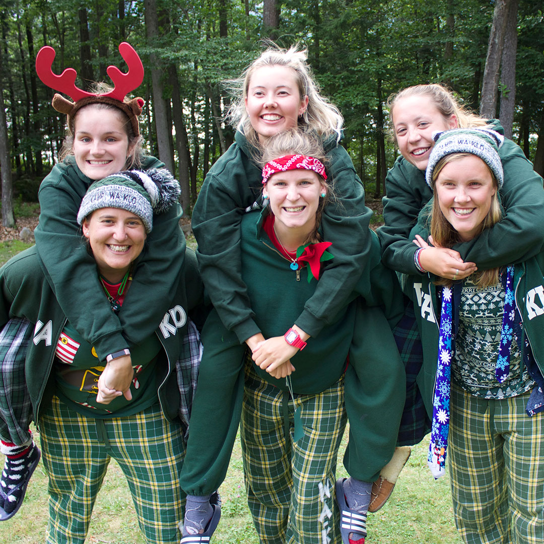 Camp Counselors celebrating camp Christmas