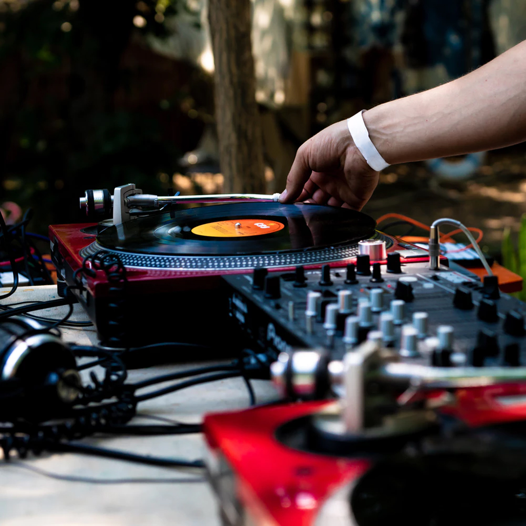 DJ Instructor playing music at Summer Camp