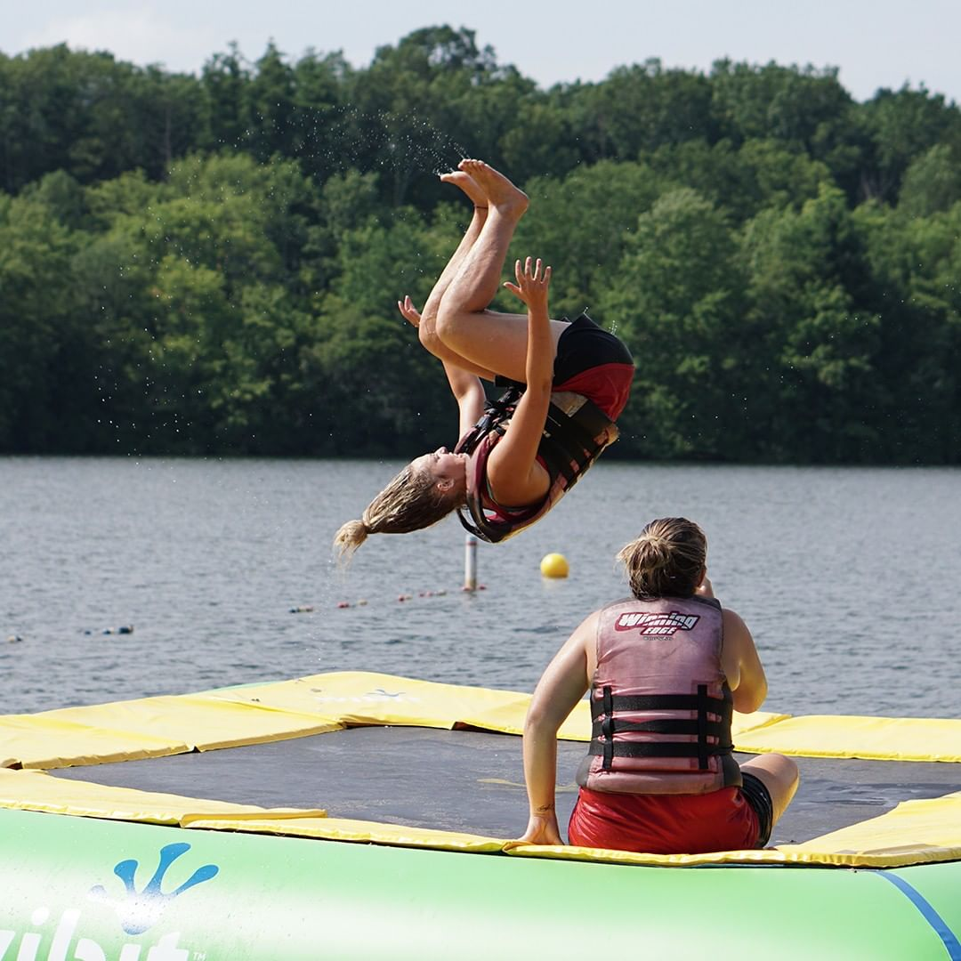 Camp Counselors having fun on the lake trampoline