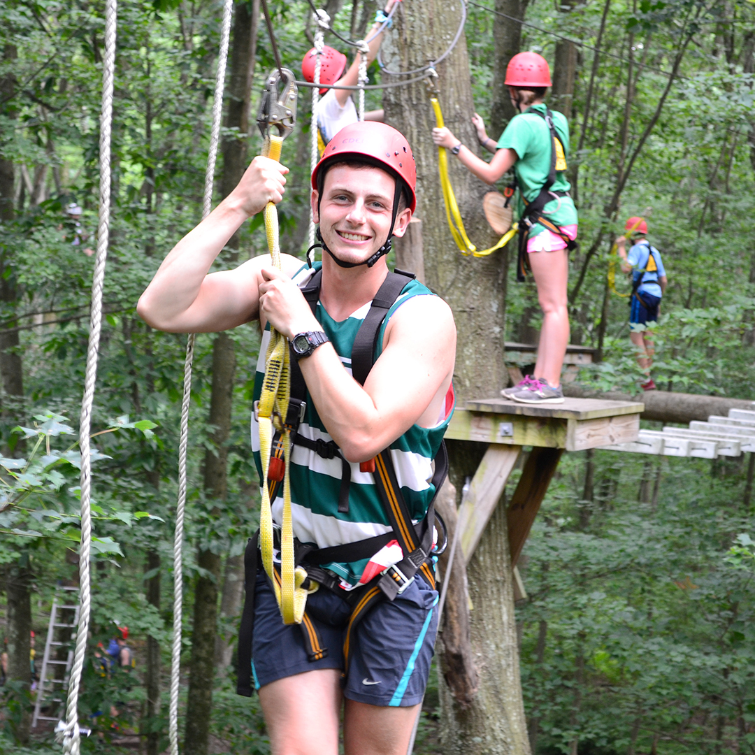 Camp Counselor climbing the ropes course