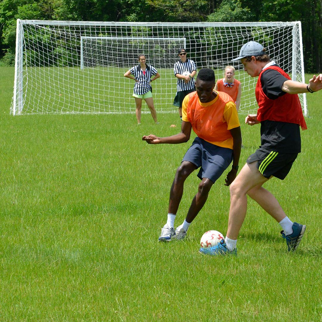 Soccer coaches teaching soccer