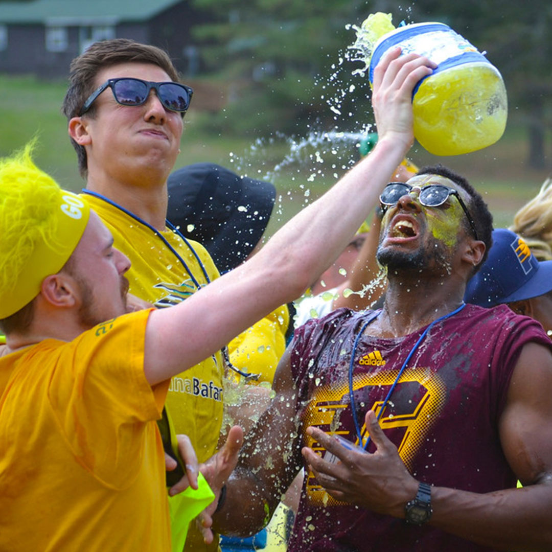 Camp Counselors being splashed with water