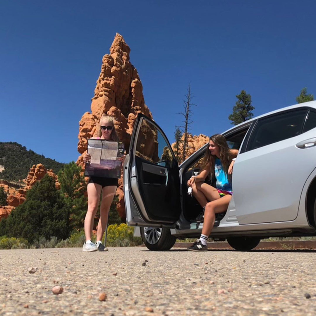 Two girls visiting Bryce Canyon on their road trip